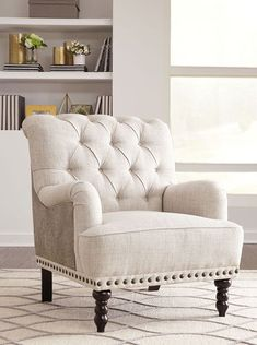 Fall in love with the Tartonelle Ivory/Taupe Accent Chair by Signature Design by Ashley at NashCo Furniture and Mattress, a family owned business proudly serving Nashville, TN and surrounding areas!