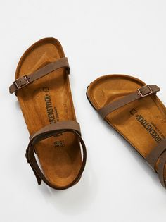 Daloa Birkenstock | Easy strappy sandals with an adjustable ankle strap and toe band with Birko-Flor uppers. Molded footbed and shock-absorbing EVA sole.