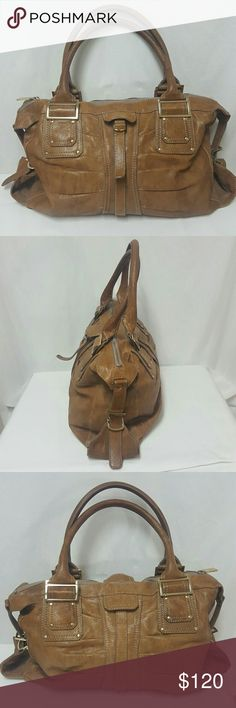 Kooba large brown leather satchel tote bag Kooba purse in mint condition. Leather, gold-tone Hardware, zipper closure , inside zip pocket, to inside slide Pockets, attached chain strap; 18 inches wide, 11 inches tall, depth is 5 inches , strap fall is 6.7 inches. Thank you Kooba Bags Satchels