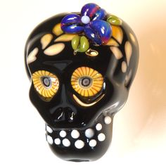 "RWD shiny black lampworked glass ""Talavera Calavera"" skull focal bead with handmade murrini eyes, ""opal"" floral detail. $45 - sold 10/2015 Renee Wiggins Design"
