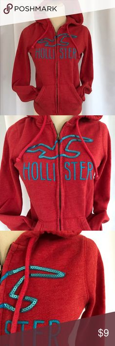 🛍Sale! Hollister Red w/ Blue Logo Full Zip Hoodie Hollister Red with Blue Logo Full Zip Hoodie Embroidered and sequined logo Soft Heathered Red Color  Has place for headphones to line inside of jacket.  Has some lint balls on inside of jacket In good preloved condition Size Small Hollister Tops Sweatshirts & Hoodies