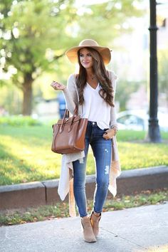 Beige wrap cardigan, floppy hate, white tee, denim jeans, tan bag and booties