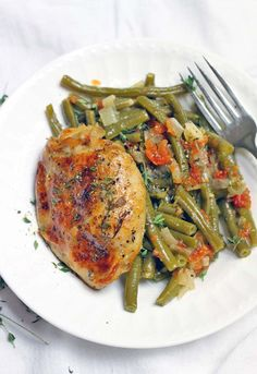 Slow Cooker Greek-Style Green Beans and Chicken thighs is the ULTIMATE one-pot meal: everything cooks in your crockpot at once! Plus, it's cheap, whole30/paleo, low carb, and healthy.