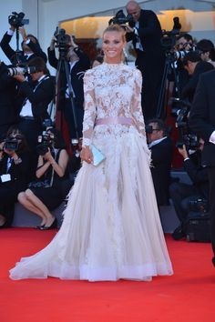 Fiammetta Cicogna, in occasion of the opening ceremony of the 69th Venice Film Festival, wore a special silk chiffon V neck dress with long lace sleeves and full tulle underskirt by Alberta Ferretti.