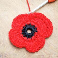 crochet flowers ideas 2 - Get those hooks out. here's a free Remembrance Poppy Crochet Pattern. Diy Crochet Flowers, Crochet Crown, Crochet Puff Flower, Crochet Flower Tutorial, Knitted Flowers, Crochet Flower Patterns, Crochet Crafts, Crochet Projects, Crochet Ideas