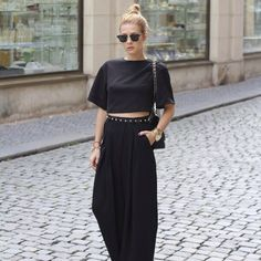 Black crop top with black maxi skirt and spiked belt.