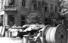 Polish barricade with captured Jagdpanzer 38(t) tank destroyer at Napoleon Square Warsaw Poland 3 August 1944. Pin by Paolo Marzioli