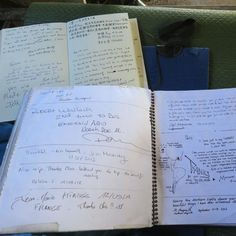 Into the McCandless Bus/Stacks of logbooks, the pages full of messages from visitors, remain in the bus.