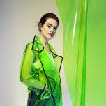 """One of the hottest Spring 2018 trends is plastic rainwear. Designers are coining this trend """"in the clear"""". The plastic raincoats can be seen from PVC trenches to tinted vinyl jackets. The transparent rainwear looms are gaining popularity. Ashley B. 11/12/17"""