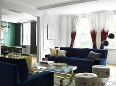 The living room's vintage stools are covered in a Neisha Crosland fabric, the painting is by Agnes Barley, and the curtains are of a Jim Thompson silk with a custom ombré dye.   - ELLEDecor.com
