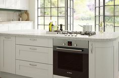 - B&Q the UK's Number 1 Kitchen Retailer offering the IT Brookfield Textured Mussel Style Shaker kitchen Shaker Kitchen, New Kitchen, Kitchen Ideas, Grey Kitchens, Fitted Kitchens, Kitchen Diner Extension, Neutral Kitchen, Mussels, Kitchen Design