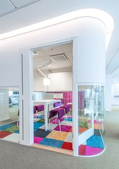 Punches of color on flooring denoting different space     HSBs New Stockholm Offices