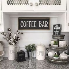 Beautiful coffee bar set up ideas on this kitchen counter. Love the Rae Dunn cof. Beautiful coffee bar set up ideas on this kitchen counter. Love the Rae Dunn coffee mugs and canisters and that organizer is a great tounch Modern Kitchen Wall Decor, Stylish Kitchen, Kitchen Wall Art, Farmhouse Kitchen Decor, Farmhouse Style, Modern Farmhouse, Farmhouse Ideas, Country Kitchen, Cottage Kitchens