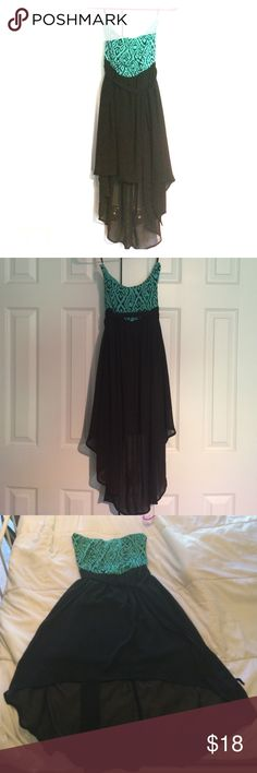 Strapless Dress Cute Aztec teal and black pattern. This dress and a black tie for around you midsection. It also has a short skirt in front and longer skirt in the back Iris  Dresses Strapless