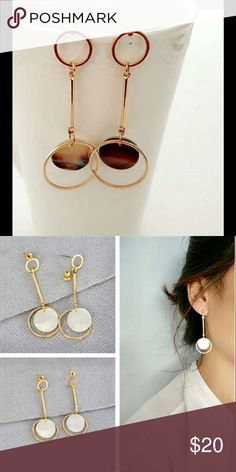 Handmade gold drops with black shell detail. Gold circle drops in gold plate with black shell detail. White shell drops shown, but I only have black shells. Anthropologie Jewelry Earrings