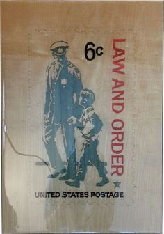 """""""Law and Order""""  11.5"""" x 16.5""""  The """"Law and Order"""" USPS stamp reproduction is the perfect gift for that law enforcement co-worker, friend or family member. The plaque is inlaid with natural and color dyed wood veneer and coated with thick, durable epoxy.   Contact me through Facebook at www.facebook.com/collectablewoods or email at bmwelch@collectablewoods.com."""