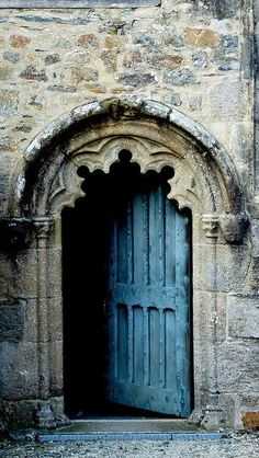 Brittany, France... It looks so dark and dismal..yet still intriguing to see whats beyond the beautiful door frame...