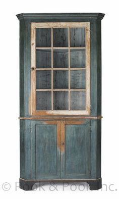 Early Cupboard...Lancaster County, Pennsylvania, painted pine one-piece corner cupboard, ca. 1790, with an ivory door...retaining an old blue/green painted surface.. ...~♥~
