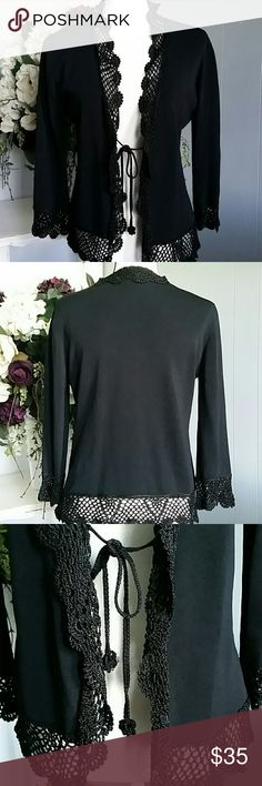 Black tie on cardigan This black and crocheted cardigan has been worn but rarely. In great condition.  75% viscose and 25% nylon. Must be hand washed or dry cleaned. Joseph A. Sweaters Cardigans