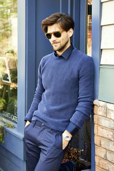 Make a blue crew-neck pullover and blue trousers your outfit choice for a sharp classy look. Shop this look for $86: http://lookastic.com/men/looks/sunglasses-dress-pants-watch-crew-neck-sweater-longsleeve-shirt/6246 — Brown Sunglasses — Blue Dress Pants — Silver Watch — Blue Crew-neck Sweater — Navy Longsleeve Shirt