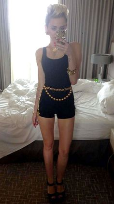 Miley Cyrus - Black Romper with Gold Jewelry