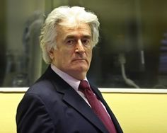 Genocide Charge Dropped Against 'Butcher of Bosnia'. In this picture taken on November 3, 2009 Former Bosnian Serb leader Radovan Karadzic appears in the courtroom of the ICTY War Crimes tribunal in the Hague. (Michael Kooren/AFP/Getty Images).