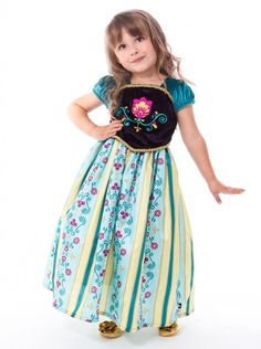 This heroine princess is ready for the party in this gorgeous dress. The china silk skirt features a beautiful custom print in a gold, teal and burgundy floral striped design. The intricate gold trim