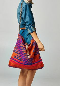 Mandeville Woven Shoulder Bag This woven two-toned triangle design shoulder bag has a leather shoulder strap and belted detail closure. made in u.s.a.
