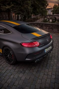 Fierce look: This Mercedes-AMG C 63 comes with a matt finish and yellow contrast. Fierce look: This Mercedes-AMG C 63 comes with a matt finish and yellow contrasting stripes. Photo by Mike Crawat for [Mercedes-AMG C 63 . Mercedes Benz Amg, Benz Car, New C Class Coupe, S Class Amg, Carros Audi, Automobile, Mercedez Benz, Supercars, Sport Cars