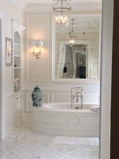 The Enchanted Home - This is how i need to dress up the built in cabinet in my bath. Beautiful molding.