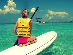 paddle boarding I feel like going to do this in a tropical place yessss