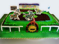 Horse race - Chocolate sheet cake with chocolate ganache. Covered in Fondant and airbrushed. Grass piped with buttercream. Tribune is out of Rice crispy and fondant. Horses are stand ups made out of icing sheets and gum paste. Horse track is out of crushed oreo's.