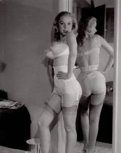 Betty Brosmer poses in her bra and girdle