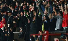 Sir Alex Ferguson and staff celebrate at the whistle.