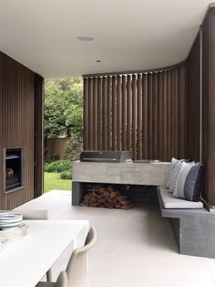 Outdoor Kitchen with builtin BBQ and pizza oven.  Balcony Over Bronte by Luigi Rosselli Architects Quincho