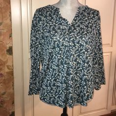 H&M Flower Top  Dark green with white flowers. Great condition, no stains or rips. Only worn a few times. Smoke and pet free home. H&M Tops Tees - Long Sleeve