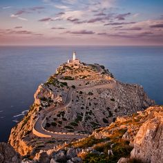 Faro de Formentor.    Formentor lighthouse on the northernmost point of the island of Mallorca lit by the setting sun.