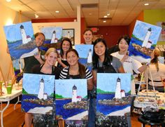 Friends with their awesome Cape Ann Lighthouse paintings at The Paint Bar!