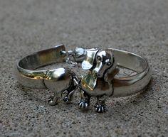 I really need one of these!!!  Dacshund Bracelet....Love it.. So do you @Angela Bostic