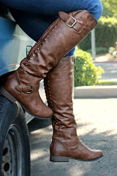 Become your own legend with these knee-high faux leather boots. It features a rounded boot-style toe with decorative studding along the back plastic zipper closure and a red lined zipper. Faux buckles