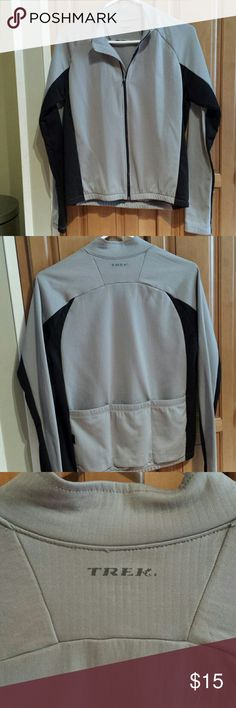 Trek Biking Jacket Size small. Trek black/gray zip up jacket with 3 pockets on the back to fit your essentials during your workout. The Trek logo on the back shows a slight wear as shown in the 3rd picture, otherwise in great condition. A must need for your active wear wardrobe! Trek Jackets & Coats