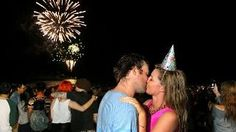 Zac Marr and Rosie Pritchard kiss during the midnight fireworks on Surfers Paradise beach