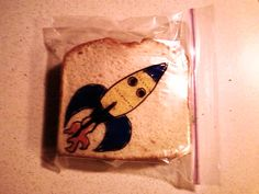 Sandwich Art by David Laferriere, Rocketship by D Laferriere, via Flickr    Since May 2008, David has been drawing on his kids' sandwich bags with a Sharpie marker. Each drawing is done just after he makes the sandwich. He takes a picture and posts it to Flickr. His kids don't see the drawing until it is lunchtime. His challenge is coming up with an idea and then drawing quickly and directly on the bag, every line counts.