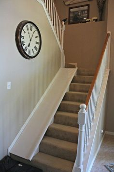 DIY indoor stair slide, with a super easy tutorial, plus the slide is easy to remove if needed for moving furniture up the stairs, etc. DecorAllure on Remodelaholic.com