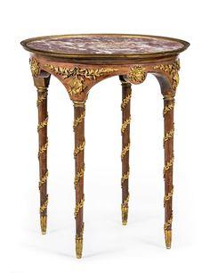 Guéridon d'époque Napoléon III, en acajou et placage d?acajou, 4 pieds fuselés, marbre brèche rosé,h. 75 cm, diam. 62 cm