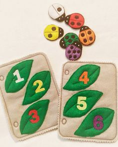 2 felt ladybug counting and color matching quiet book pages. Each page has 3 leaves with a colored number on it and a pocket in the back to hold the 3 lady bugs for that page plus 3 lady bugs with the