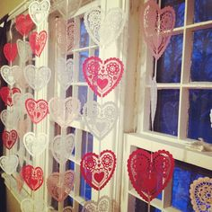 Valentine's Day window decorations with paper doilies and ribbon. Cheap and easy! #valentinesday #decorations by mindfuljenn, via Flickr