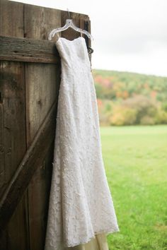 A portrait of the bride's gown at the Historic Barns of Nipmoose. Andrea Casey Photography