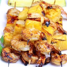 Sweet shrimp and pineapples are marinated in a honey glaze to create these amazing Shrimp and Pineapple Kabobs!