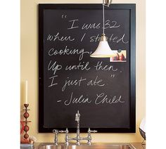 Chalkboard on the kitchen wall with funny quote :)